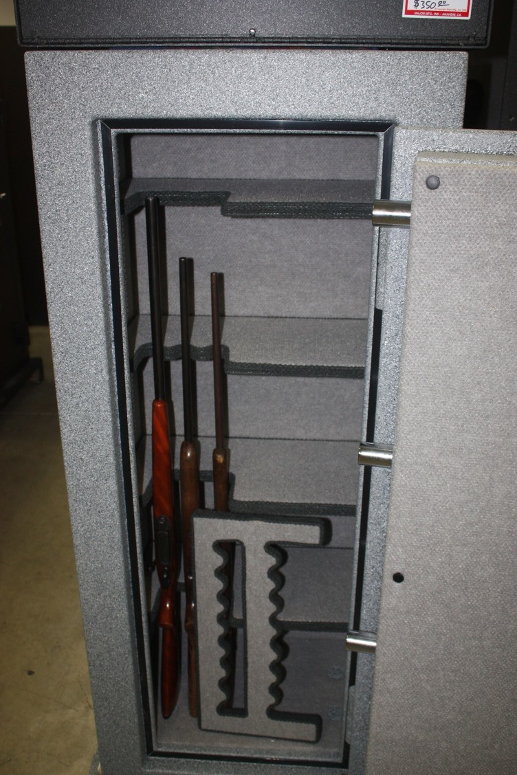 She Has Four Full Width Shelves For Jewelry, Pistols And Documents With  Just A Small Area Dedicated To Long Guns.